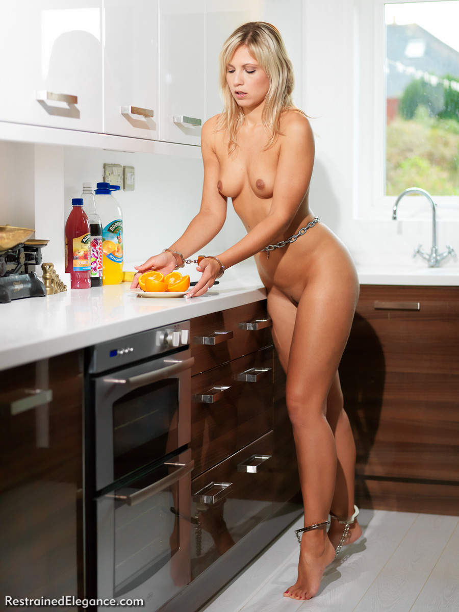 Slavegirl Jenni is made to do the kitchen chores- naked and in chains!