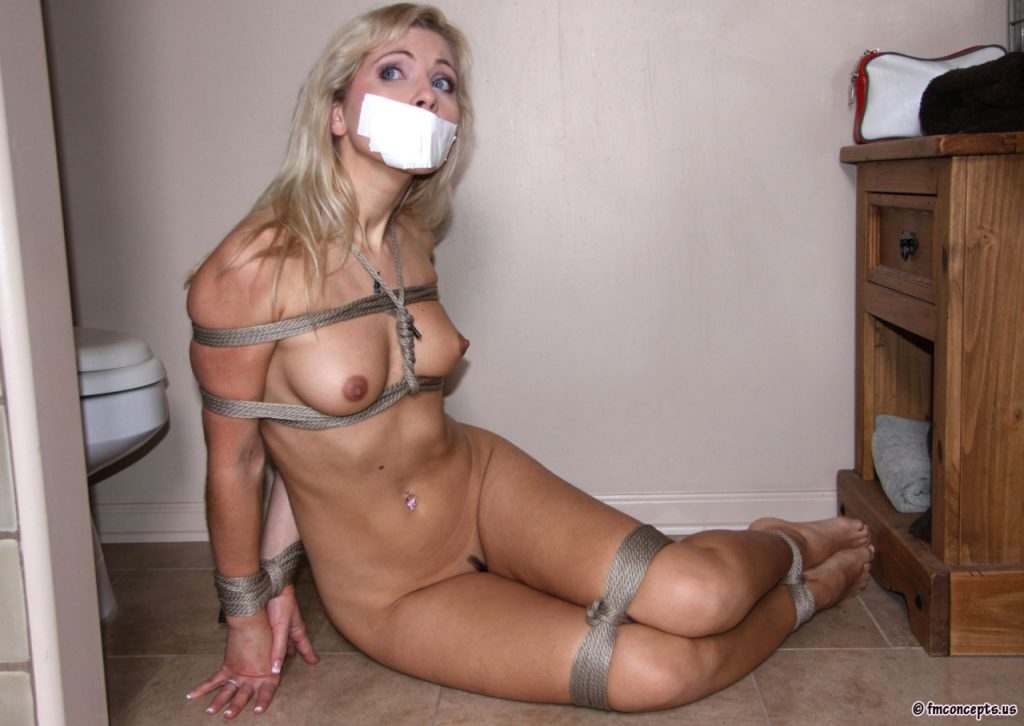 Wild Amateur Subbie Is Bound And Gagged With Bondage Tape Pics 1